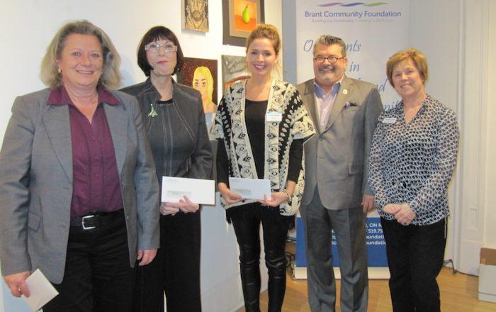 Education sector grants presented to area charitiy representatives.